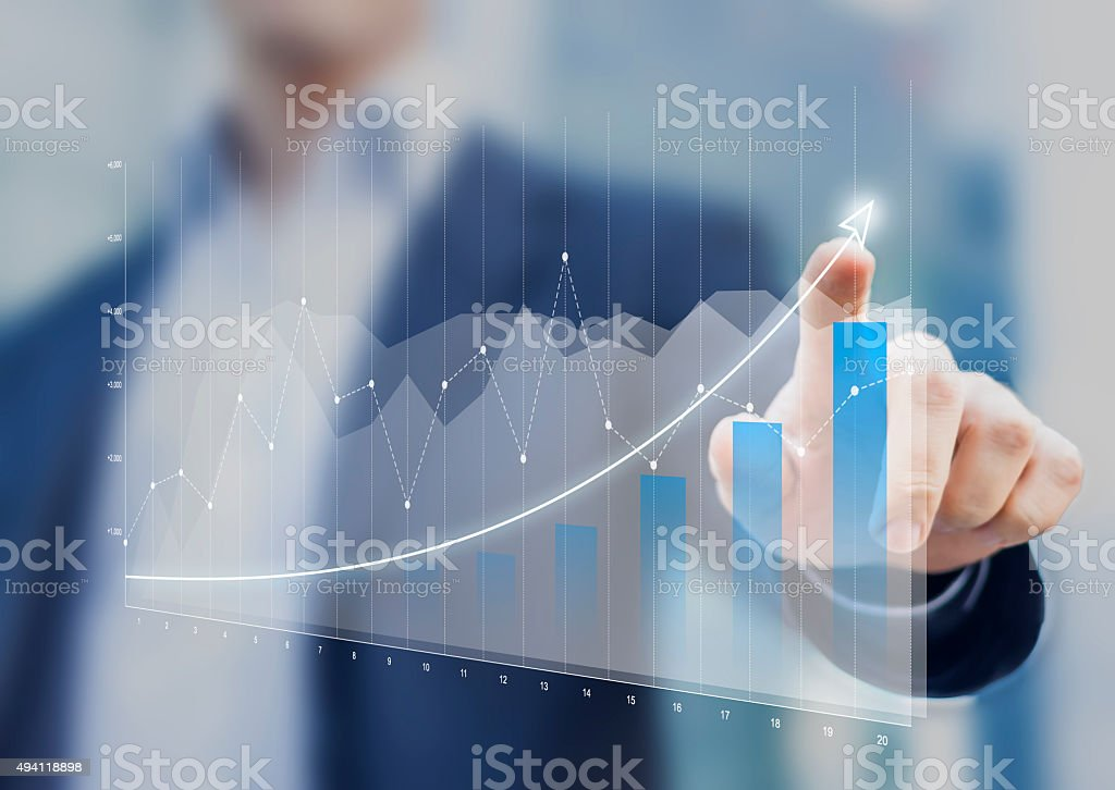 Financial charts mostrar crecimiento de los ingresos en pantalla táctil - foto de stock