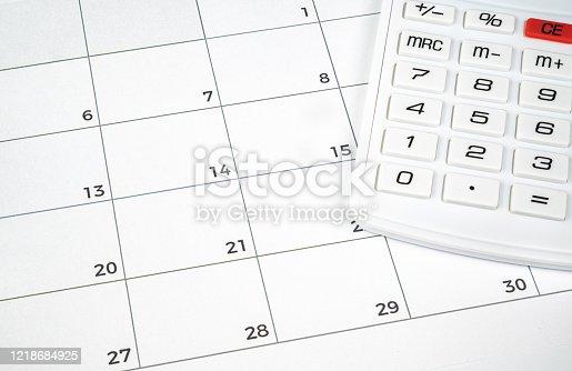 A financial concept with a calculator on the calendar