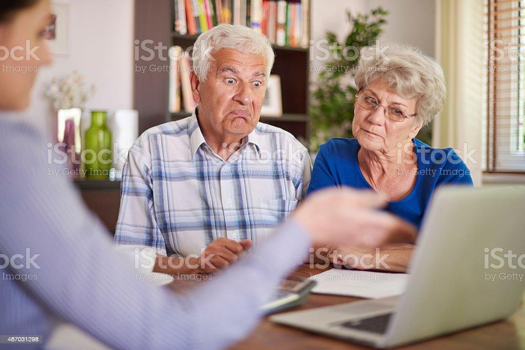 Financial counsellor giving an advice to senior couple Financial counsellor giving an advice to senior couple 2015 Stock Photo