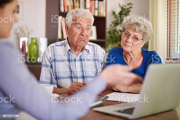 Financial Counsellor Giving An Advice To Senior Couple Stock Photo - Download Image Now