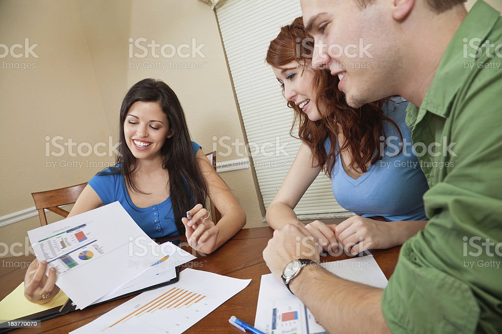 Financial Counselor Showing Charts To Young Couple royalty-free stock photo