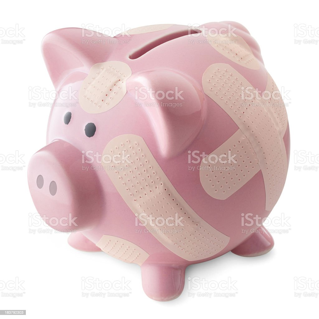 Financial crisis. Piggy bank with band aids. royalty-free stock photo
