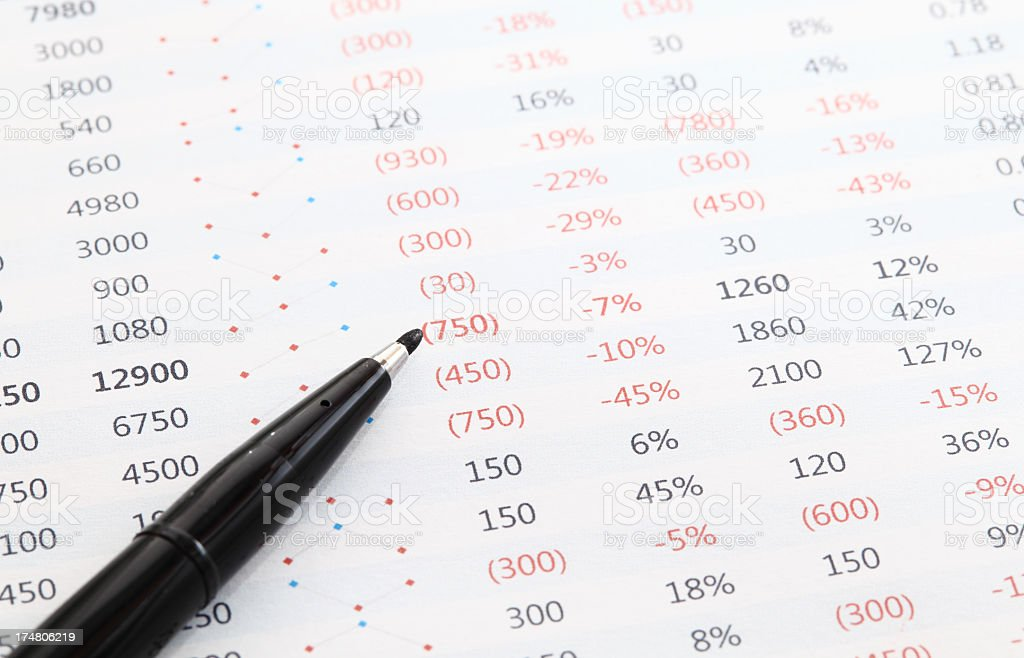 financial data analysis with pen stock photo