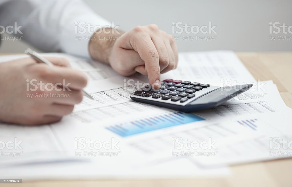Financial data analyzing. Counting on calculator. royalty-free stock photo