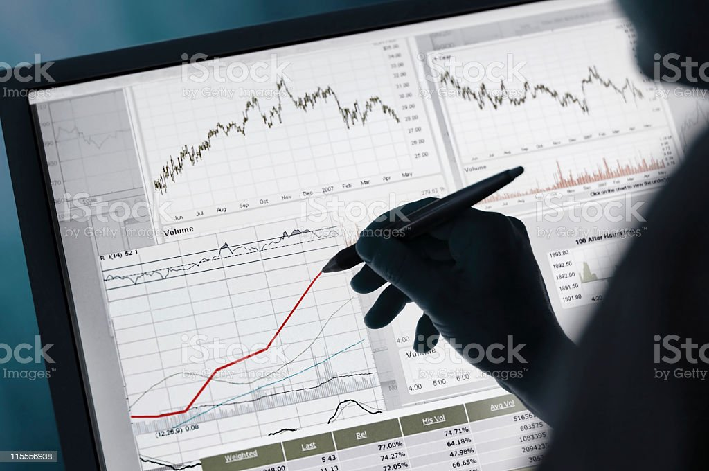 Financial Data Graphs on Computer stock photo