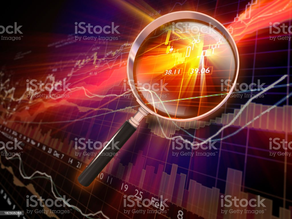 Financial Data with Magnifying Glass royalty-free stock photo