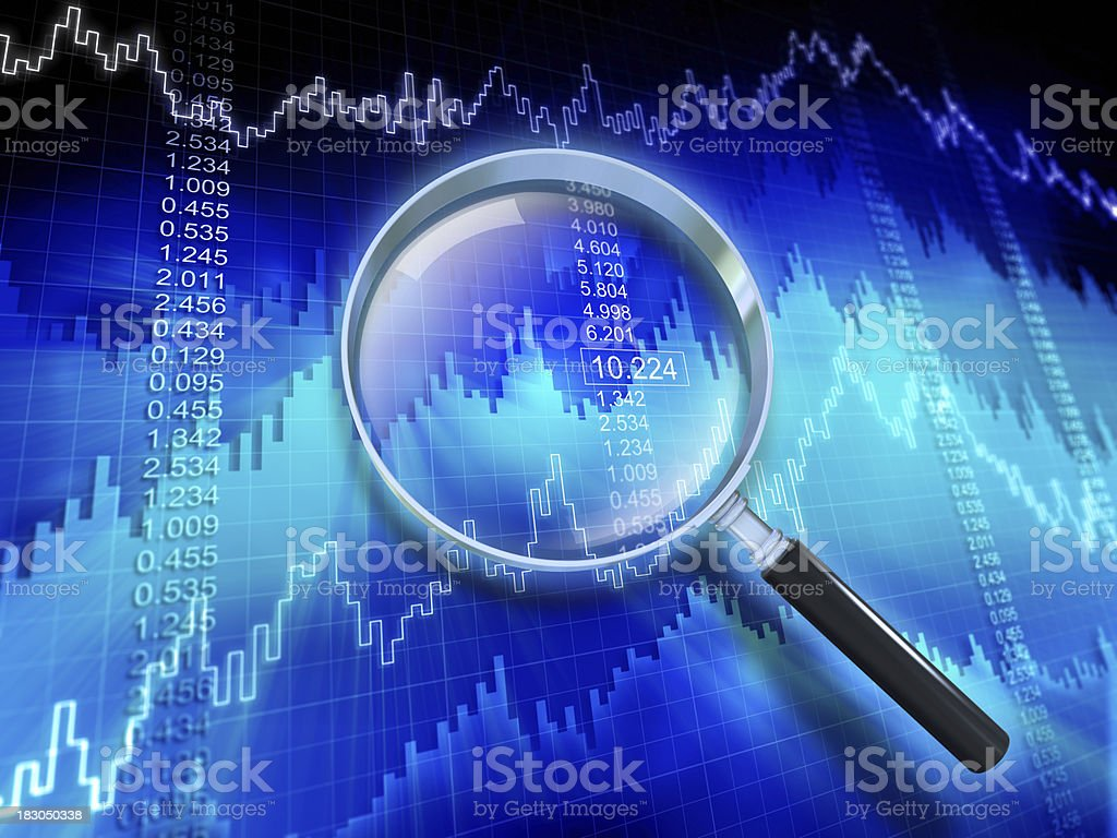 Financial Data with Magnifying Glass stock photo