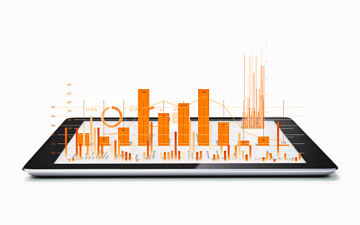 Financial Diagrams And Charts Being Projected From A Digital Tablet Stock Photo - Download Image Now