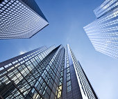 Looking up at business buildings in a financial district