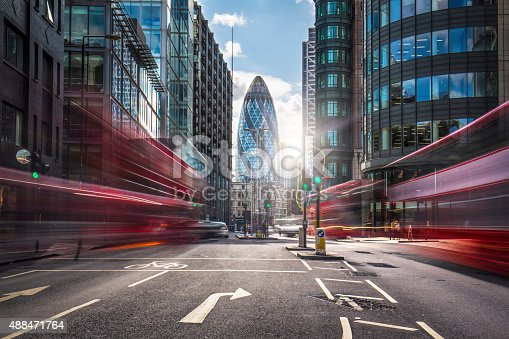 Buses on the street at the financial district of London.