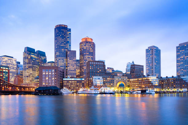 Financial District Skyline and Harbour at Dusk in Boston stock photo