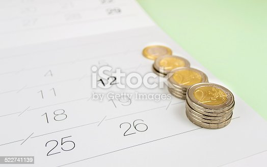 Studio shot of columns of coins isolated on a white background