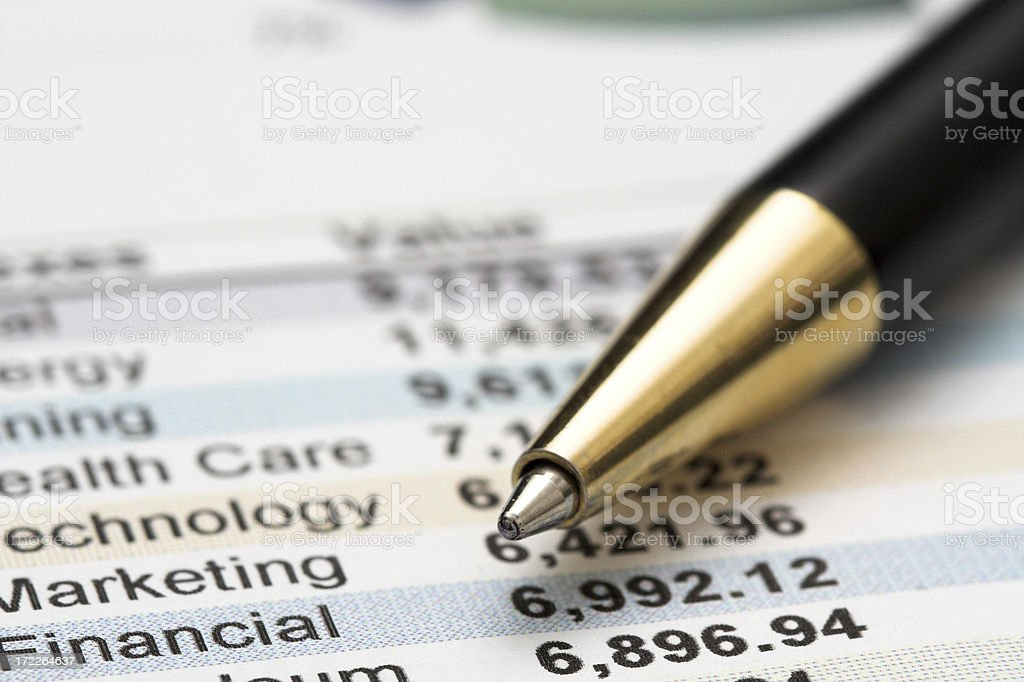 Financial figures and a pen royalty-free stock photo