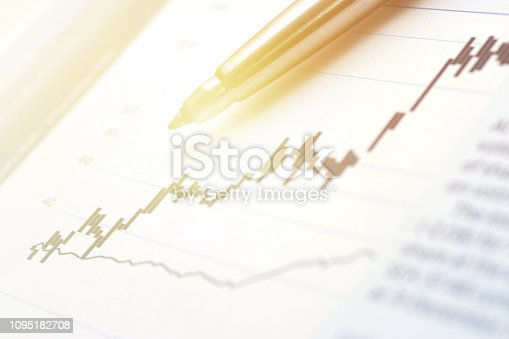 Close-up of financial report figures with pen.