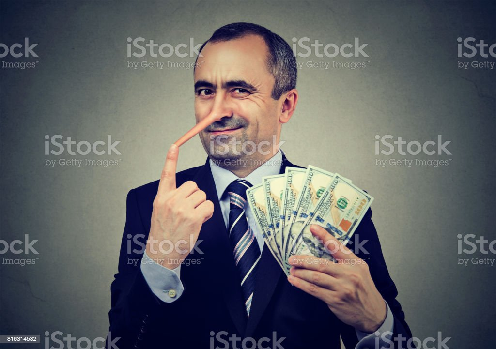 Financial fraud concept. Liar businessman with dollar cash stock photo
