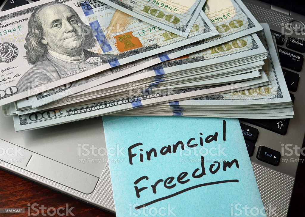 Financial Freedom  concept on a paper with notebook. stock photo