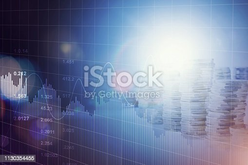 istock Financial futuristic blue charts and graphs and coins stack background 1130354455