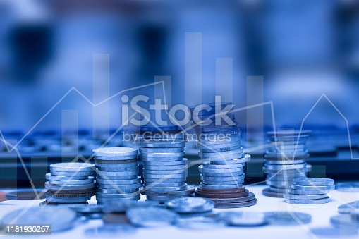 istock Financial graph with coins on background. Earning money concept. 1181930257