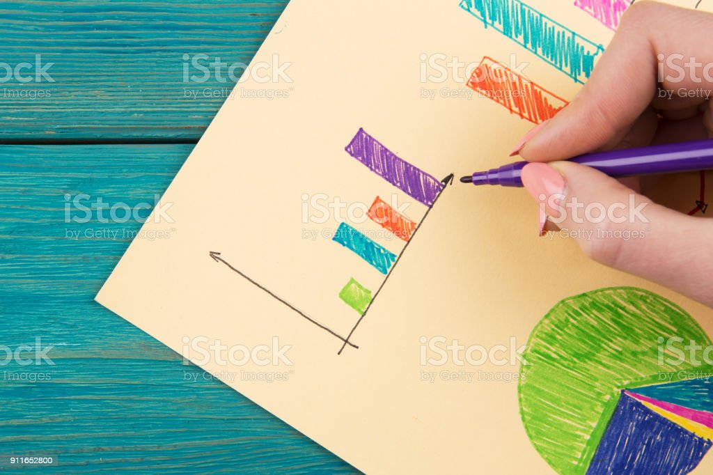 Financial graphs drawn with colored pens stock photo