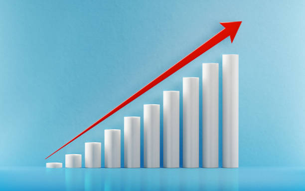 financial growth bar with a red arrow shape moving up over blue background - diagramma a colonne foto e immagini stock