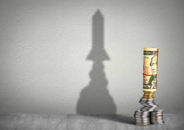 financial growth concept, money with rocket shadow stock photo