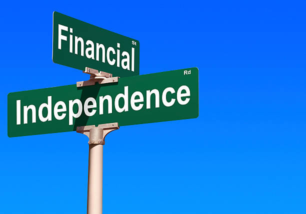 financial independence street sign - independence stock photos and pictures