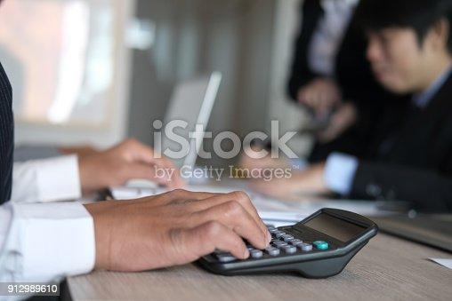 istock financial inspector analyze accounting plan report. businessman working with new startup project. internal auditor audit performance revenue. business meeting at office. 912989610