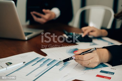 istock financial inspector analyze accounting plan report. businessman working with new startup project. internal auditor audit performance revenue. business meeting at office. 920143480