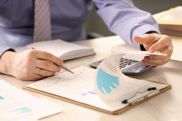 Financial Inspector Report Calculating Balance Financial Inspector Report Calculating Balance. Internal Revenue Service Worker Checking Document. Audit Concept. Businessman Control Finance Using Calculator. Analyzes Economy Profit control stock pictures, royalty-free photos & images