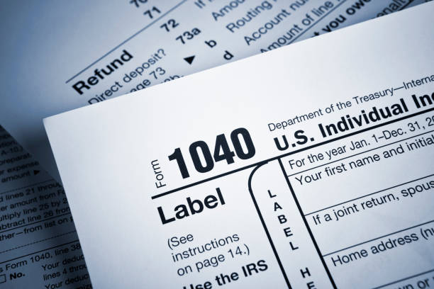 Financial IRS tax return forms Income tax numbers at the accountants office 1040 tax form stock pictures, royalty-free photos & images