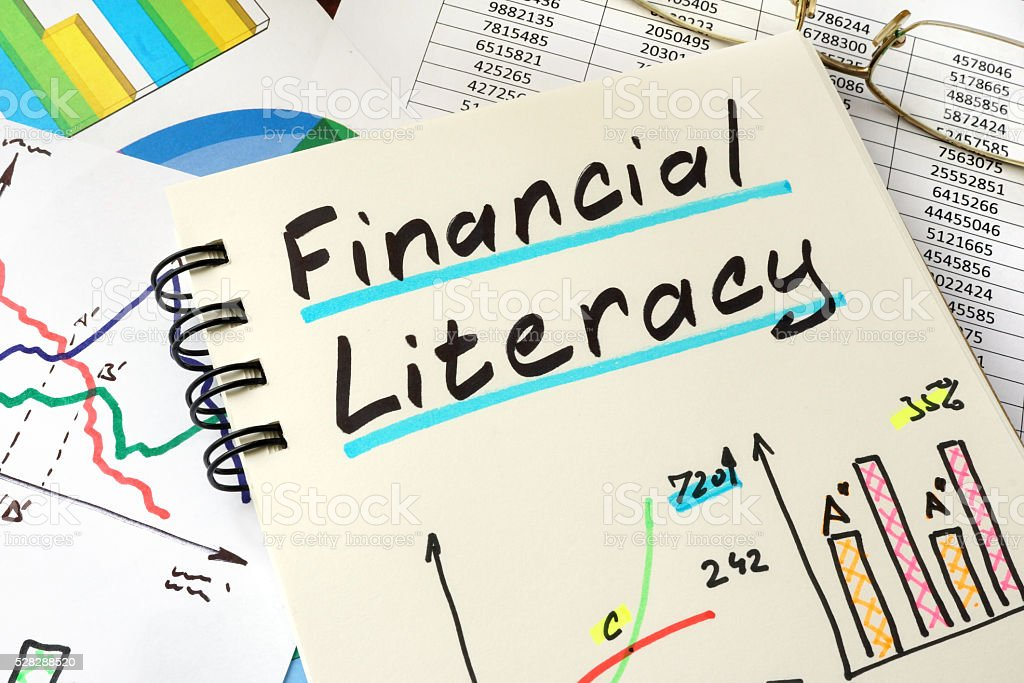 Financial Literacy written on a notepad sheet. Education concept. stock photo