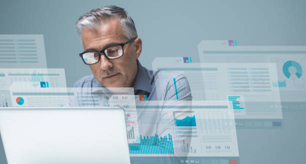 Financial management and technology Businessman reading financial reports on visual screens and working with a laptop, finance and technology concept financial report stock pictures, royalty-free photos & images