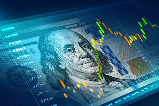 The stock market chart on 100 dollar bill background