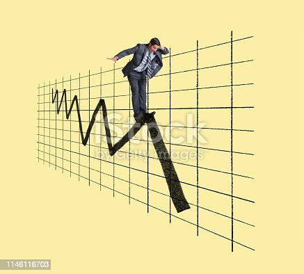 A frieghtened businessman places his hand on his head as he looks down toward the next leg of a very volatile financial chart against a yellow background.