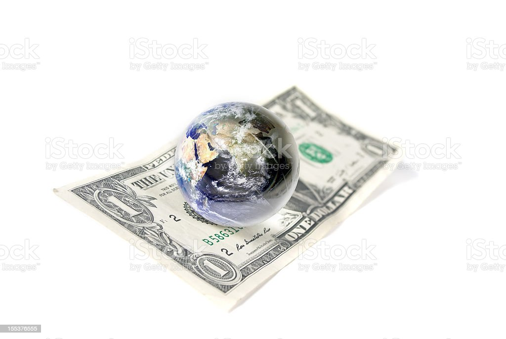 financial markets;whole world sitting on the US dollar. royalty-free stock photo