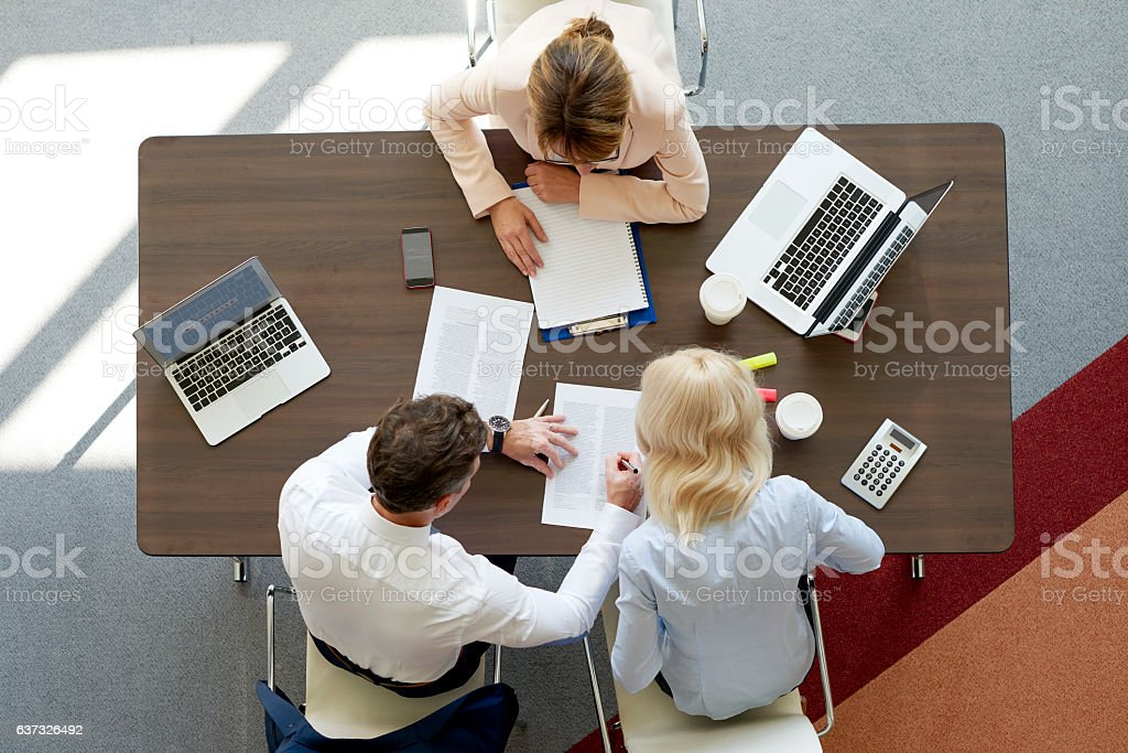 Financial meeting at office Top view of professional investment advisor woman consulting about financial plan with business management. Administrator Stock Photo