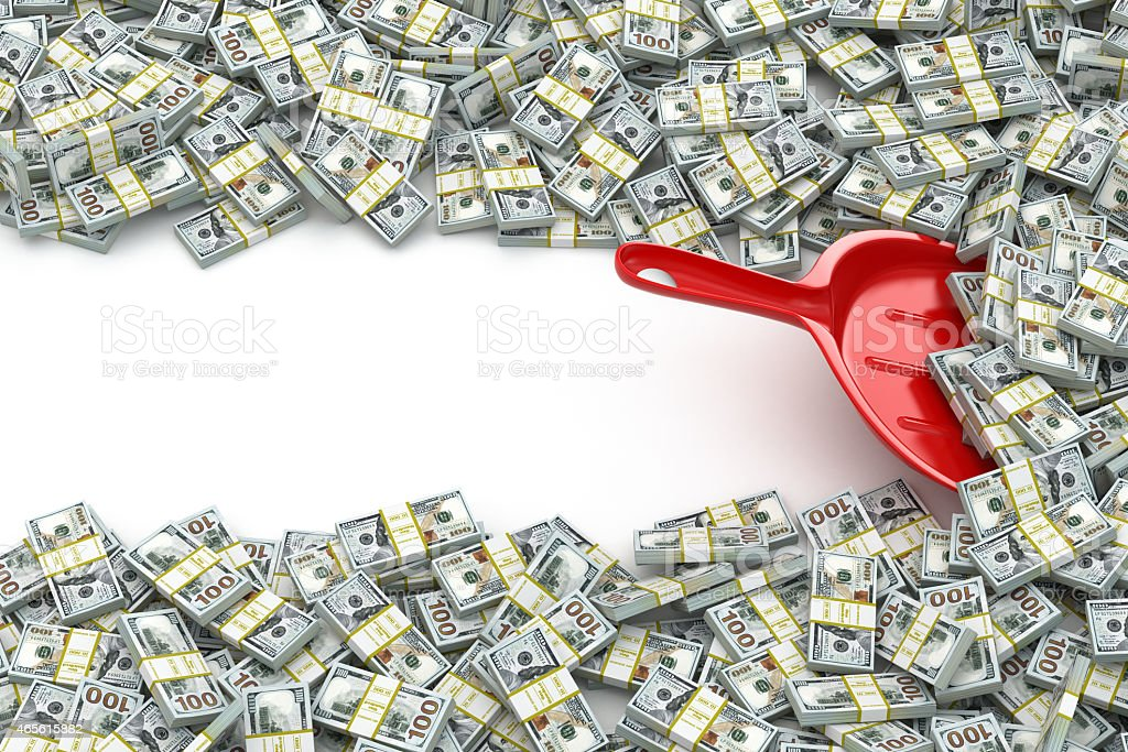 Financial money concept. Scoop and packs of dollars. stock photo