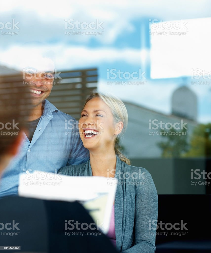 Financial planner meeting with a couple royalty-free stock photo