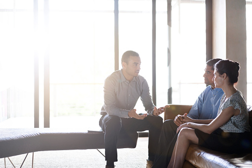 istock Financial planner talking with couple in office 626623282