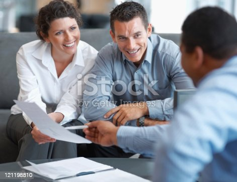 istock Financial Planning - Couple getting consulted 121198810