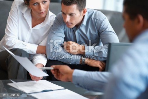 istock Financial Planning - Couple getting consulted 121198814