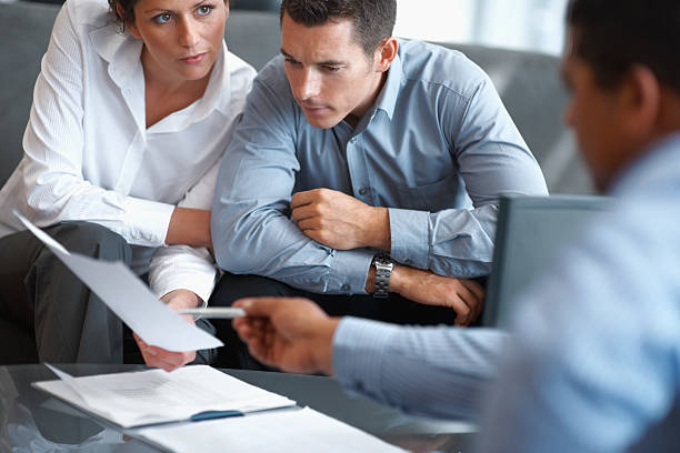 Financial Planning - Couple getting consulted stock photo