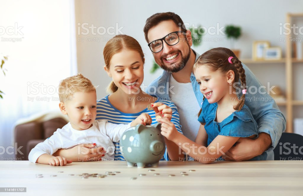 financial planning   family mother father and children with piggy Bank at home financial planning happy family mother father and children with piggy Bank at home Adult Stock Photo