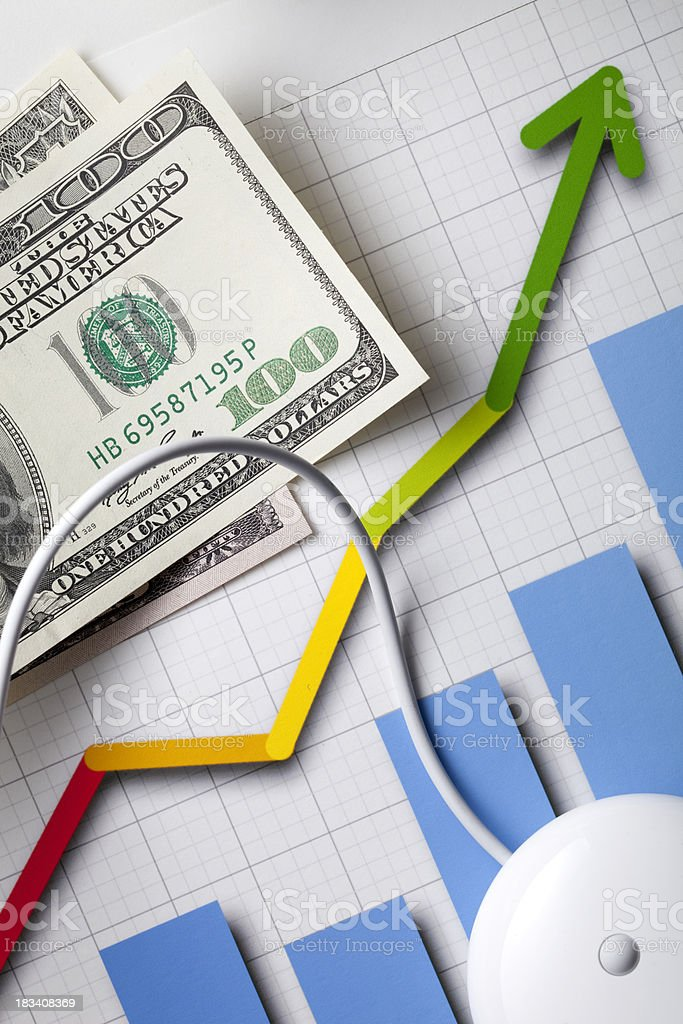 Financial Planning. Graph with a mouse and dollar banknotes. royalty-free stock photo
