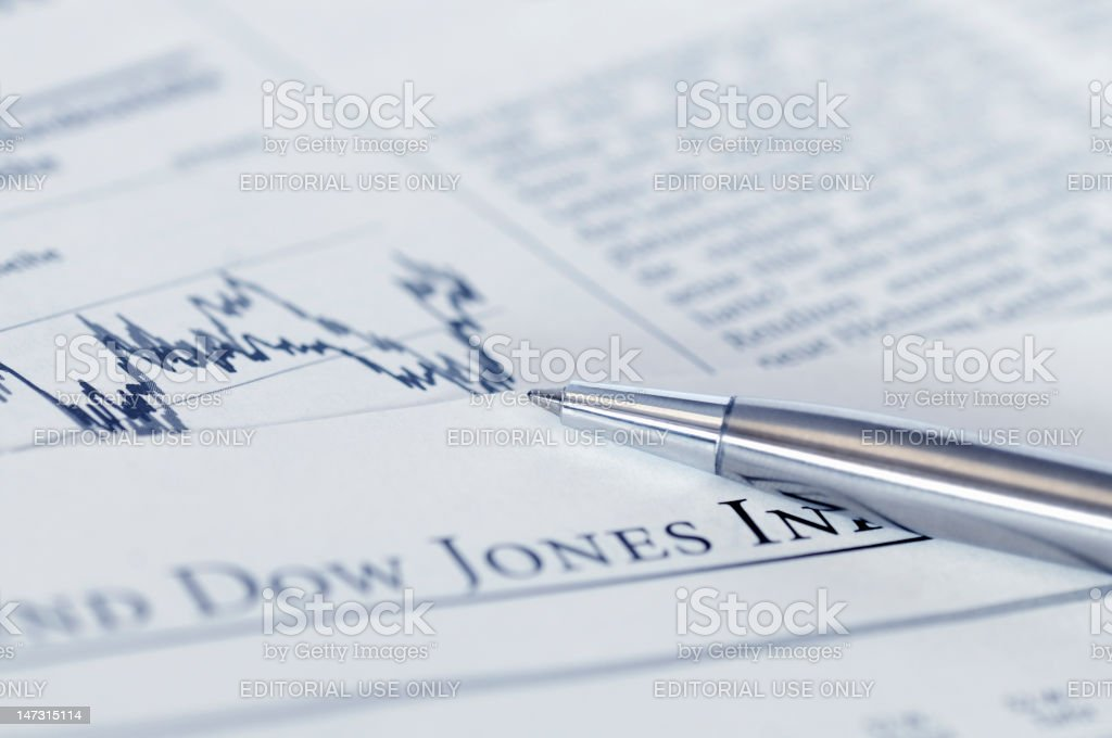 Financial planning with stock chart and pen. stock photo