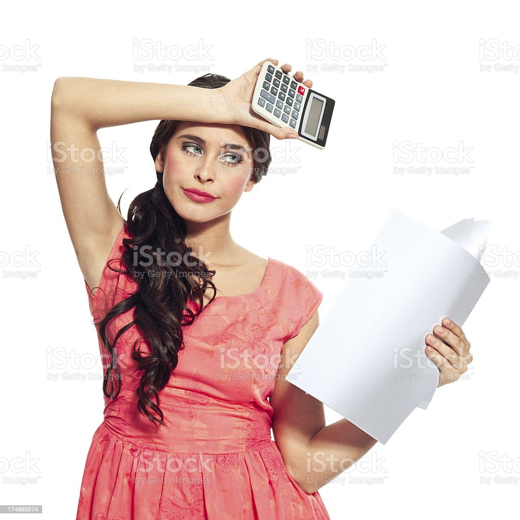 Financial problems Young woman looking worried at the bills. Studio shot on a white background. 20-24 Years Stock Photo