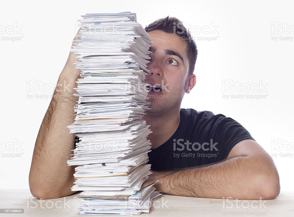 Financial Problems, Young Man with Paperwork Overload and Unpaid Bills royalty-free stock photo