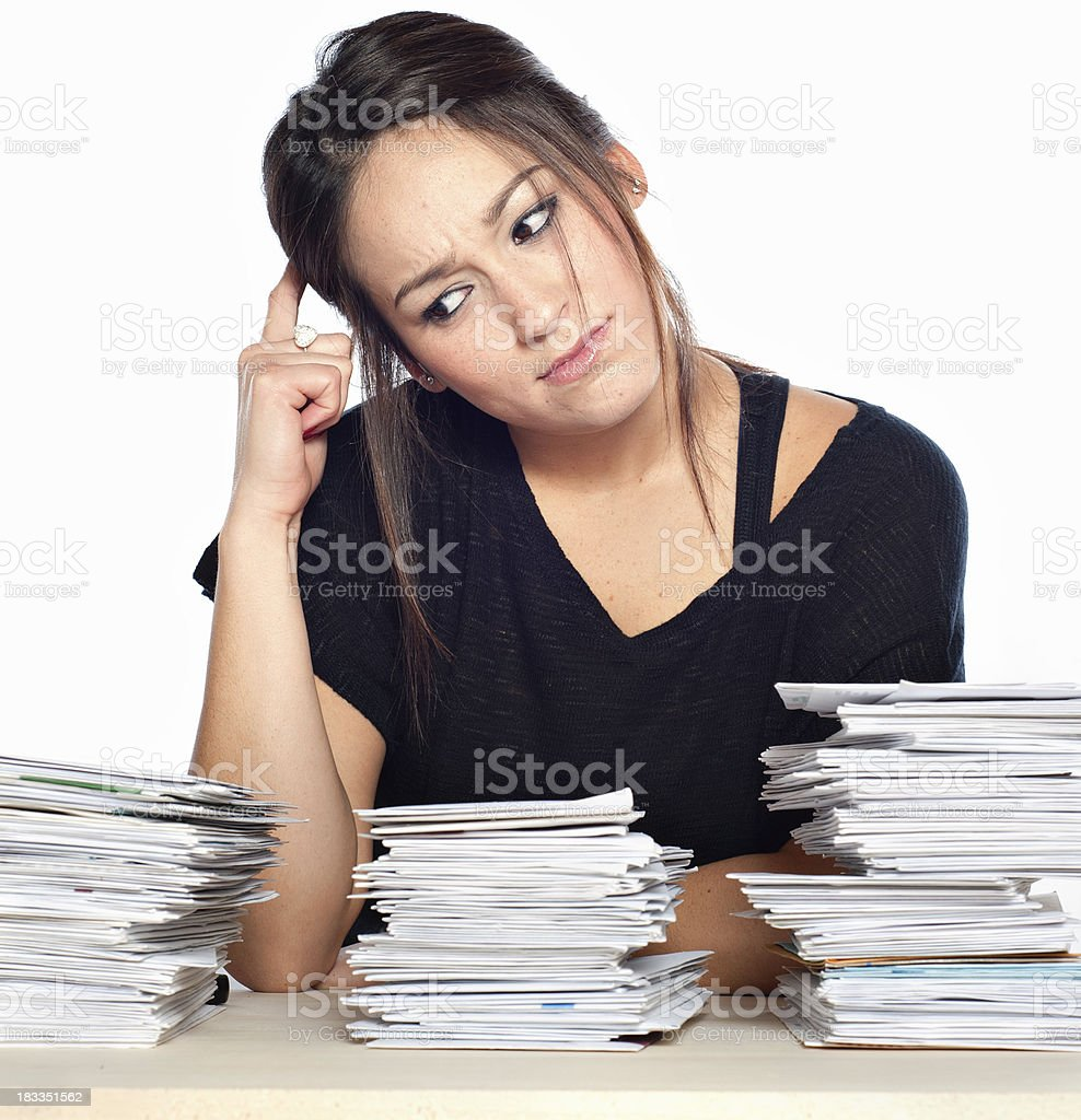 Financial Problems, Young Woman with Unpaid Bills and Paperwork Overload royalty-free stock photo