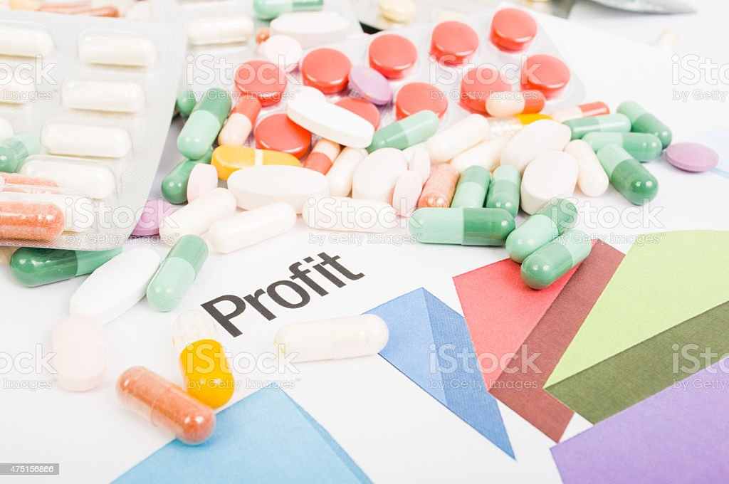 Financial profit from pills sales stock photo