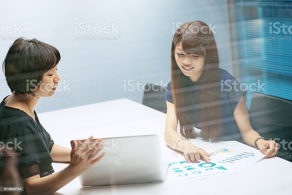 Software engineer talking to manager about project challenges and...